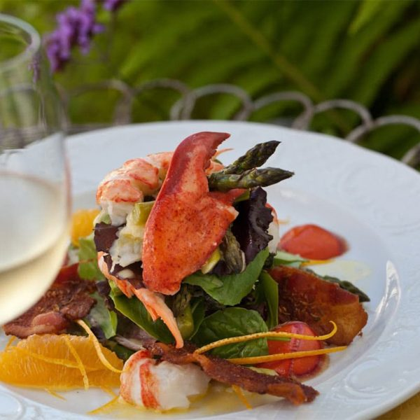 Seafood salad with glass of white wine