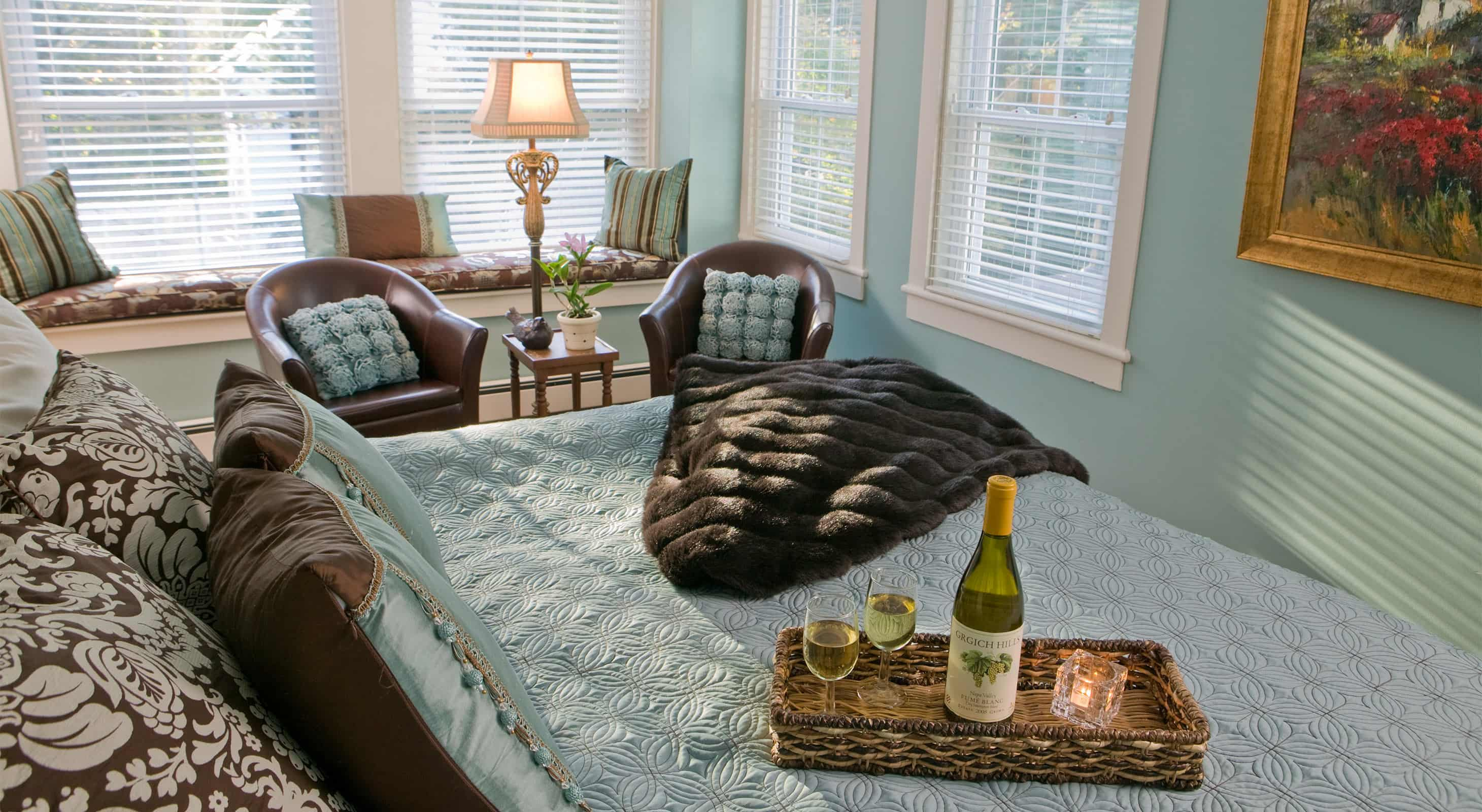 Bed with wine in the Sweet Woodfruff room at our Maine Coast Inn