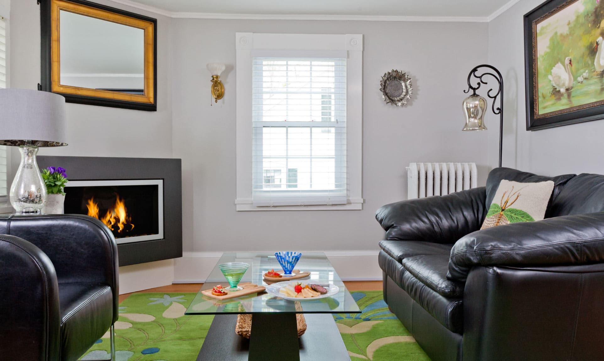 Living room with gas fireplace, couch, and leather chair