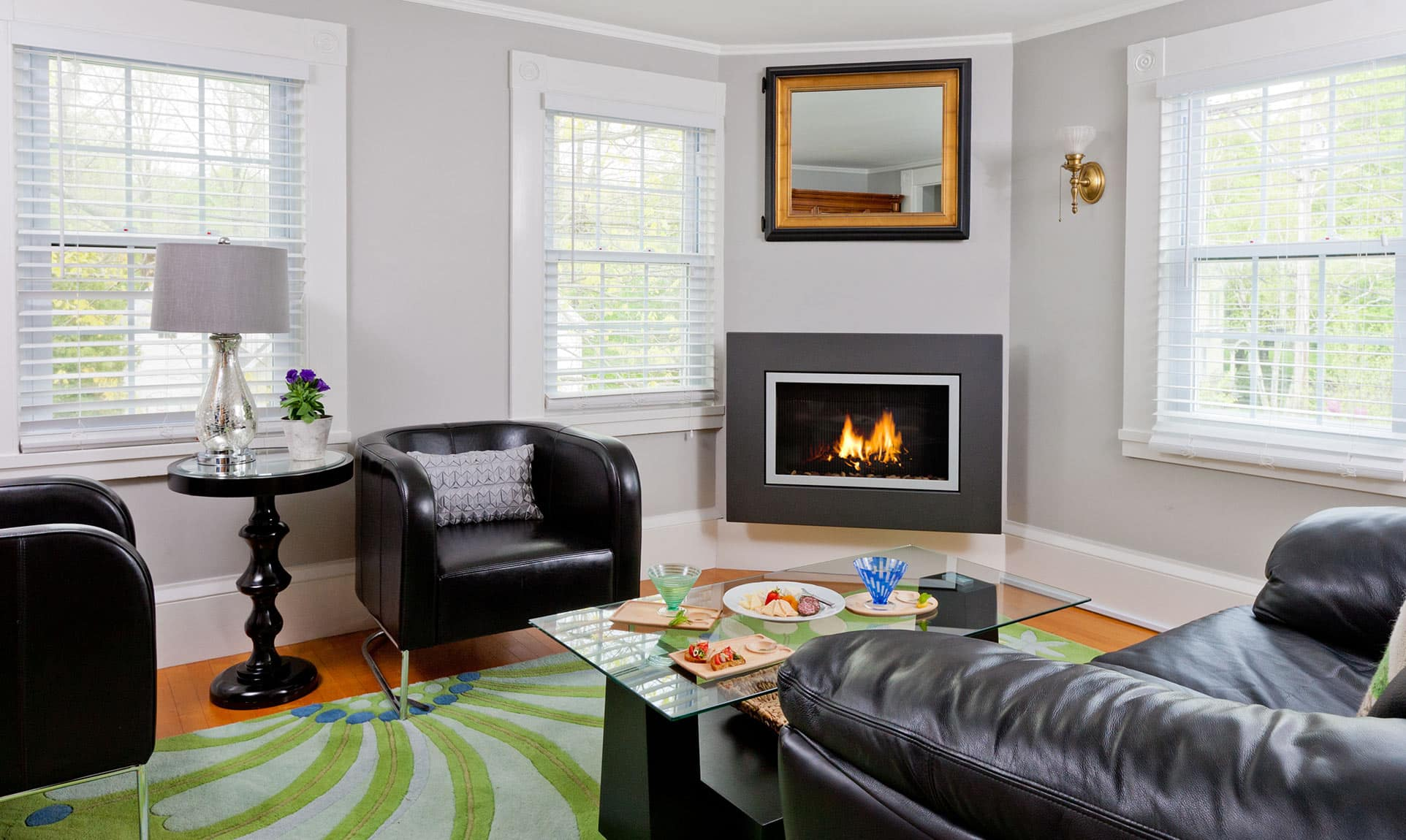 Living room with gas fireplace, couch, and leather chairs
