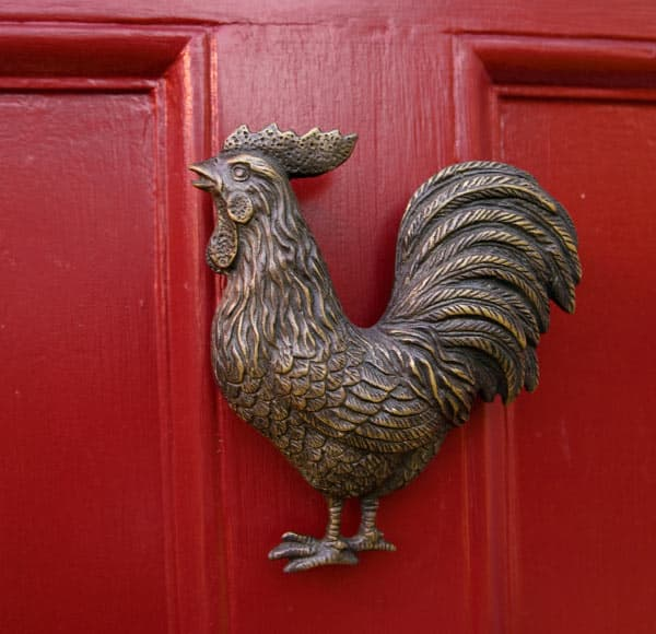 Rooster knocker on a red door