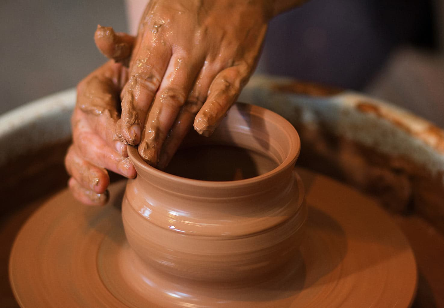 hands on a pottery wheel