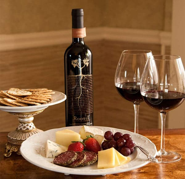 Red wine and cheese plate with crackers