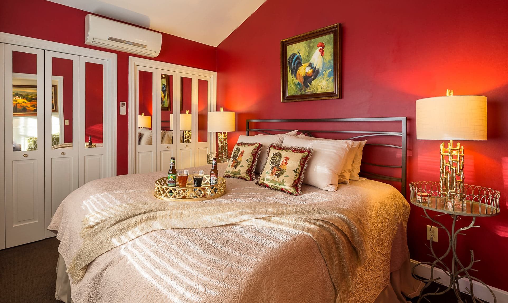 King Bed in Cottage Suite with Red Walls and Rooster Painting
