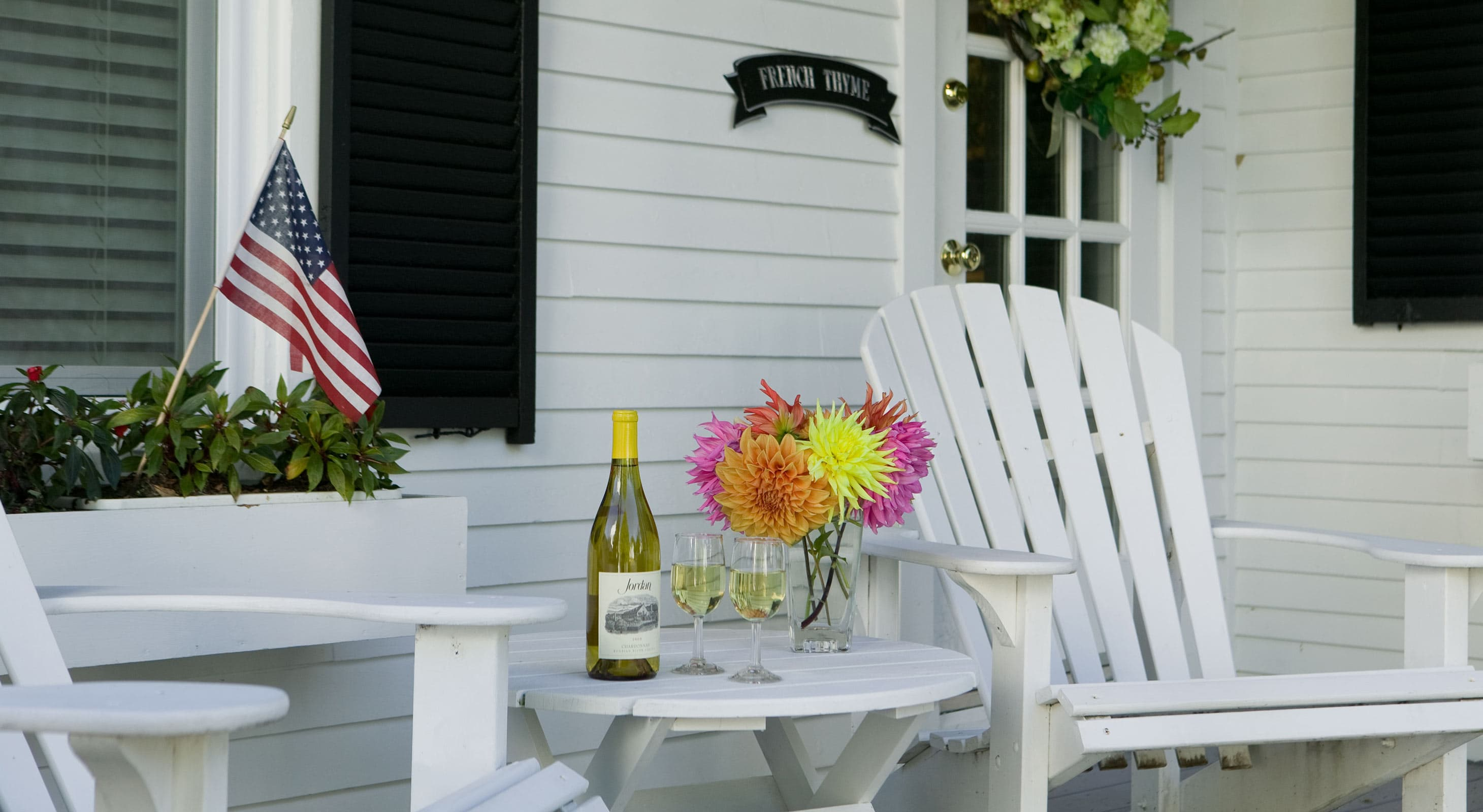 White wine with Adirondack chairs on patio