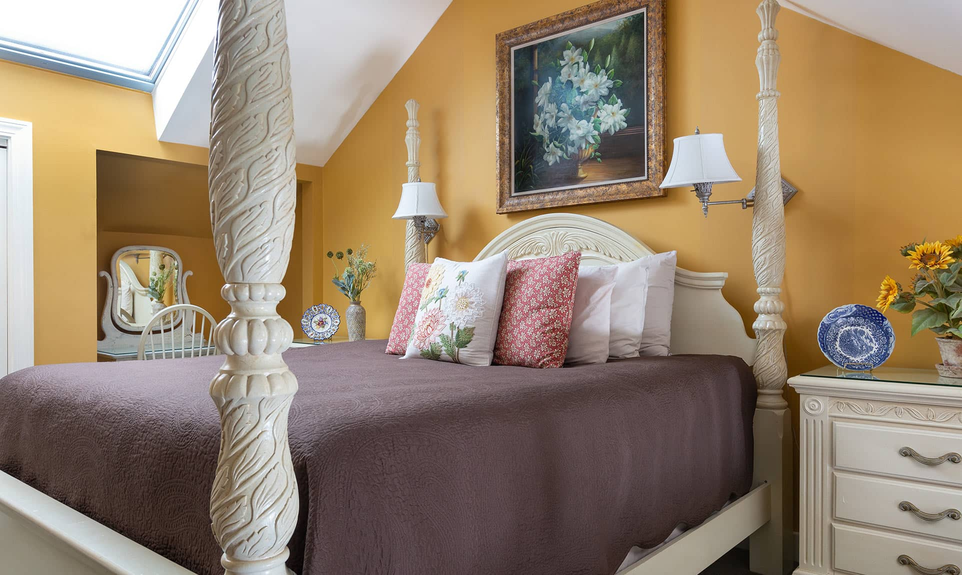 Bed in Garden Suite with skylight above