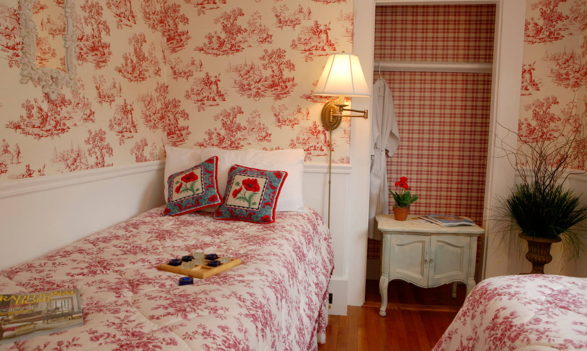 Second Bedroom with Two twin beds in shades of red