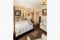 Bed and two chairs in Mansard Room