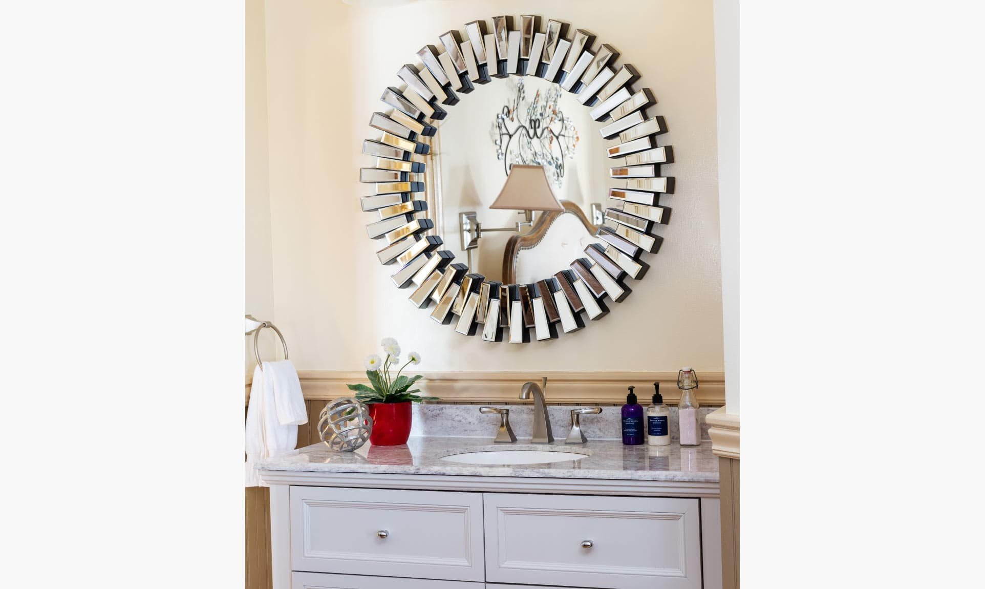 Vanity with round mirror above in Provence Room