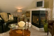 Sitting Room with Fireplace and TV