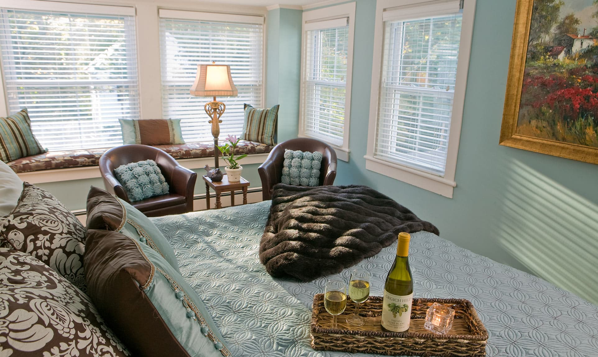 Bed with wine in the Sweet Woodruff room at our Maine coast B&B