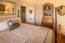 Bed and armoire in Tally Ho Room