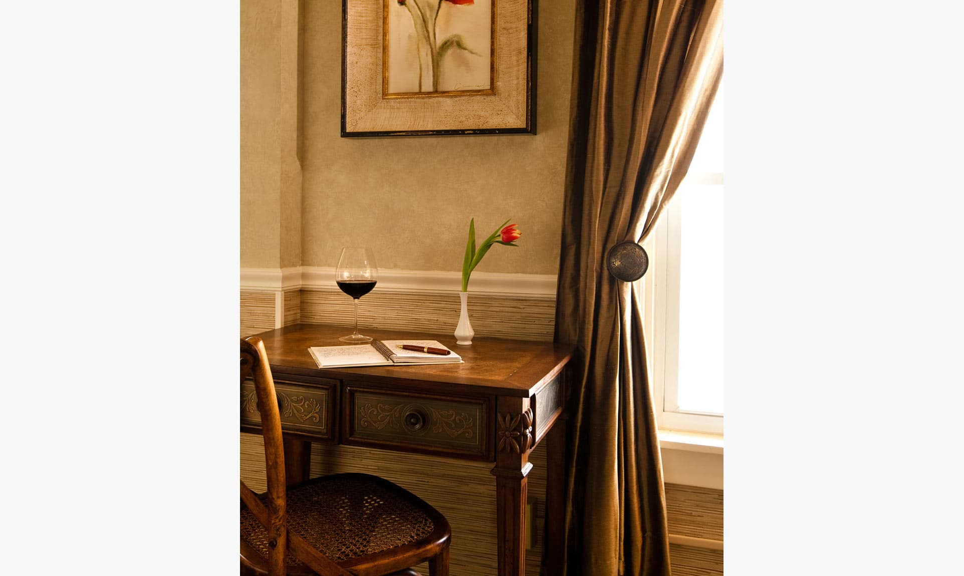 Writing desk with wine and flower in The Loft