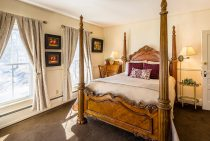 Four Poster bed in the Toscana Room at our Camden boutique hotel
