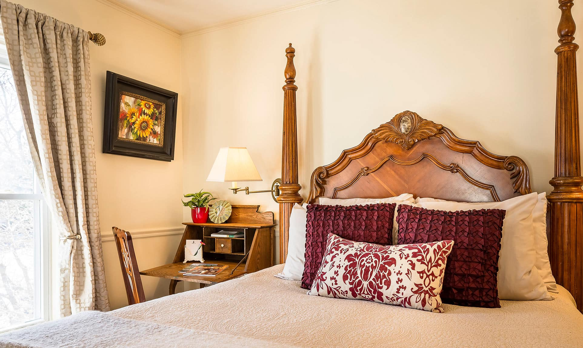 Bed and writing desk in the Toscana Room at our Camden, Maine boutique hotel