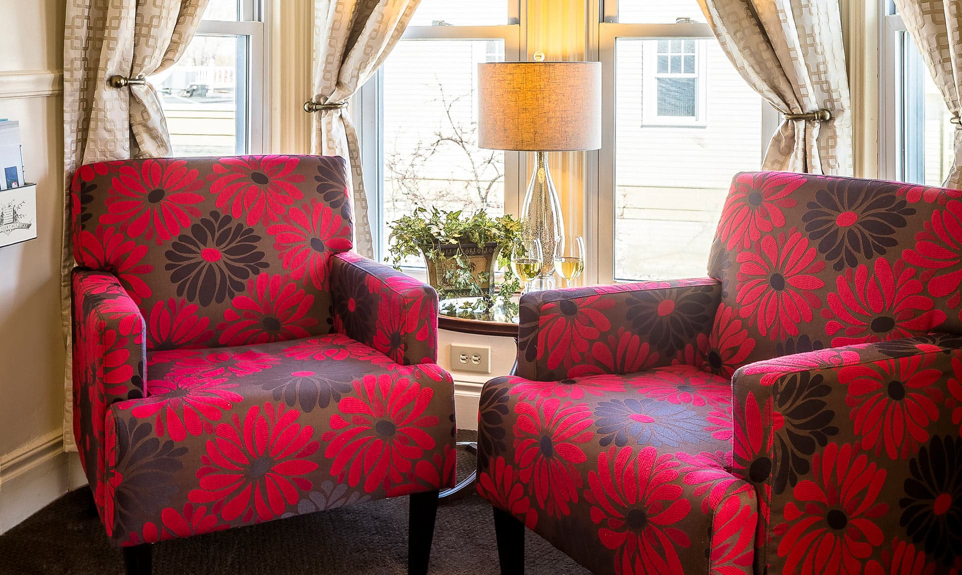Two comfy red chairs in Sitting Area