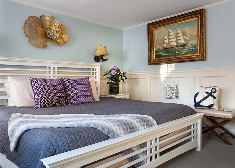 King Bed in Viola Room with artwork and bench