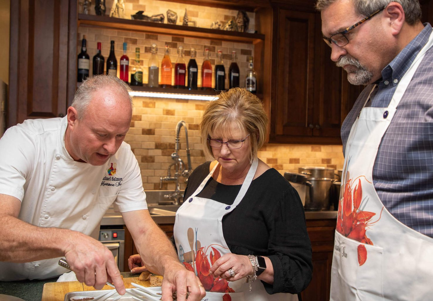 Couple with Chef Michael Salmon at a cooking class