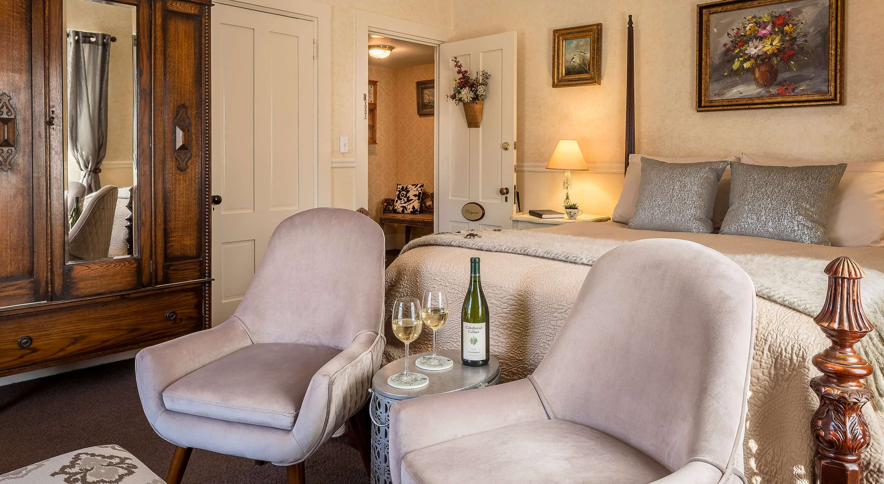Luxurious room with a bed and seating area at our Camden bed and breakfast