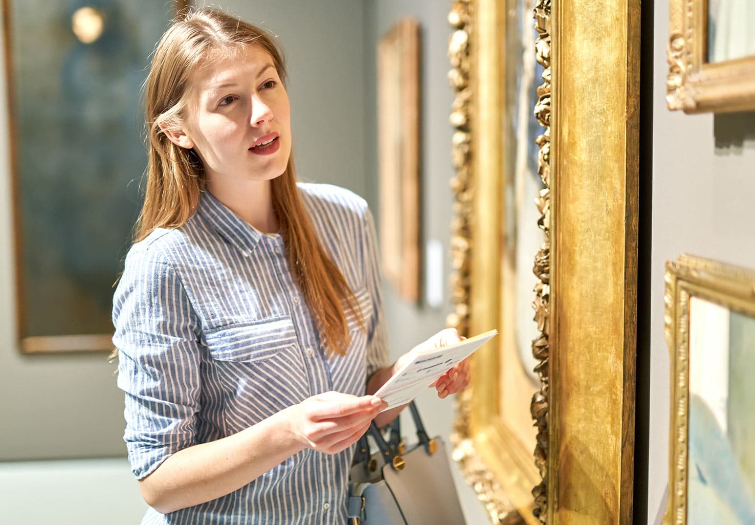 Woman looking at art in an art museum